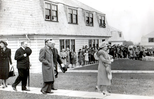 King George VI and Elizabeth, Queen Consort, 1947 opening the post war emergency housing units build by Claude Selleck.